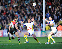 Nick Evans of Harlequins chips over Benjamin Kayser and Morgan Parra of ASM Clermont Auvergne during the Heineken Cup Round 5 match between Harlequins and ASM Clermont Auvergne at the Twickenham Stoop on Saturday 11th January 2014 (Photo by Rob Munro)