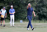 23rd August 2020, Boston, MA, USA;  Dustin Johnson, of the United States, points to the sky on the 17th fairway as lightning strikes pausing play during the final round of The Northern Trust  at TPC Boston in Norton, Massachusetts.
