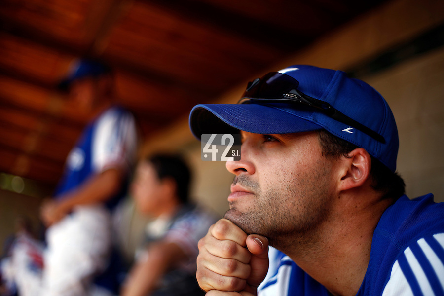 24 June 2011: Vincent Ferreira of Team France. Illustration of a photographic essay called Life in the dugout, during France 8-5 win over UCLA Alumni, at the 2011 Prague Baseball Week, in Prague, Czech Republic.