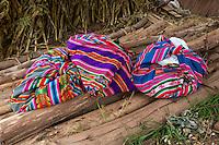 Peru, Urubamba Valley, Quechua Village of Misminay.  Village Women's Bundles.