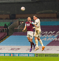 9th January 2021; Turf Moor, Burnley, Lanchashire, England; English FA Cup Football, Burnley versus Milton Keynes Dons; Phillip Bardsley of Burnley and Richard Keogh of MK Dons challenge for a header in extra time