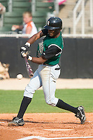 Augusta second baseman Eugenio Velez (19) makes contact with the ball in game action versus the Kannapolis Intimidators at Fieldcrest Cannon Stadium in Kannapolis, NC, Sunday, June 18, 2006.