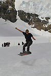 Man snowboarding in the Alps above Lauterbrunnen, Switzerland.