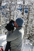Appalachian Trail - Snowshoer drinking water on the Carter-Moriah Trail in winter conditions near Middle Carter Mountain  the White Mountains, New Hampshire USA