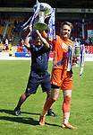 St Johnstone v Fleetwood Town…24.07.21  McDiarmid Park<br />Zander Clark holding the Scottish Cup and Betfred Cups pictured with Callum Davidson as they take a lap of honour at McDiarmid Park showing the fans the two trophies<br />Picture by Graeme Hart.<br />Copyright Perthshire Picture Agency<br />Tel: 01738 623350  Mobile: 07990 594431