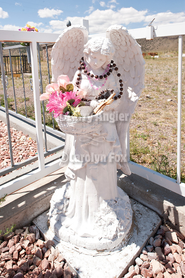 Cemetery and headstones behind the burned walls of San Ysidro Church in Las Mesitas, Colorado.
