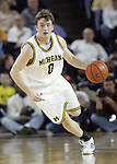 26 February 2009: Michigan guard Zack Novak dribbles the ball in a college basketball game between the Michigan Wolverines and Purdue Boilermakers at Crisler Arena in Ann Arbor, MI. Michigan upset No. 16 Purdue 87-78.