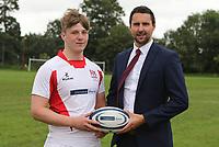 Ulster Rugby Schools 2018-2019<br /> <br /> Grosvenor GS player James McMaster with Danske Bank representative Ian Russell.<br /> <br /> Photo by John Dickson / DICKSONDIGITAL