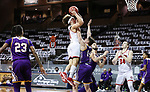 SIOUX FALLS, SD - MARCH 6: Mason Archambault #11 of the South Dakota Coyotes trees to shoot over Braden Lamar #14 of the Western Illinois Leathernecks during the Summit League Basketball Tournament at the Sanford Pentagon in Sioux Falls, SD. (Photo by Richard Carlson/Inertia)