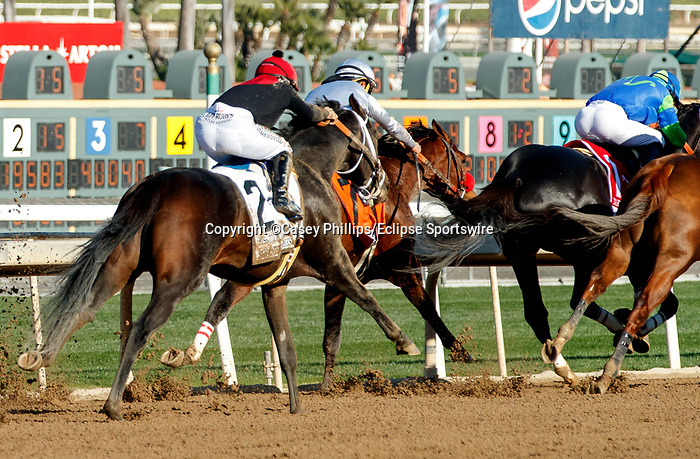 ARCADIA, CA DECEMBER 26: #2 Kiss Today Goodbye, ridden by Mike Smith, starts to take on #1 Take the One O One, ridden by Jose Valdivia, Jr., #7 Idol, ridden by Gabriel Saez, and #8 Mucho Gusto, ridden by John Velazquez, in the stretch of the San Antonio Stakes (Grade ll) on December 26, 2020 at Santa Anita Park in Arcadia, CA.<br />   (Photo by Casey Phillips/Eclipse Sportswire/CSM.)