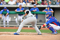 Biloxi Shuckers starting pitcher Angel Ventura (40) squares to bunt as Cael Brockmeyer awaits the ball during a game against the Tennessee Smokies at Smokies Stadium on May 26, 2017 in Kodak, Tennessee. The Smokies defeated the Shuckers 3-2. (Tony Farlow/Four Seam Images)