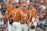 Texas Longhorns infield meets during a pitching change against the Texas A&M Aggies in NCAA Big XII Conference baseball on May 21, 2011 at Disch Falk Field in Austin, Texas. (Photo by Andrew Woolley / Four Seam Images)