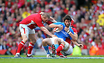 Luke Charteris and Gethin Jenkins combine to stop Mirco Bergamasco..2012 RBS 6 Nations.Wales v Italy.Millennium Stadium..10.03.12.Credit: STEVE POPE-Sportingwales