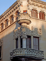 An ornately carved first floor balcony depicting flower motifs and the monogram of the first owner, Joaquin Nava