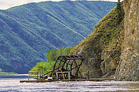 A subsistence salmon fish wheel is placed along a cliff on the Yukon River, near the village of Eagle, Alaska