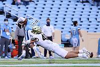 CHAPEL HILL, NC - NOVEMBER 14: Nick Andersen #45 of Wake Forest tackles Dazz Newsome #4 of North Carolina during a game between Wake Forest and North Carolina at Kenan Memorial Stadium on November 14, 2020 in Chapel Hill, North Carolina.