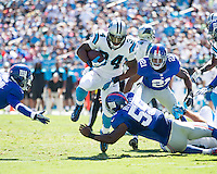 The Carolina Panthers played the New York Giants at Bank of America Stadium in Charlotte, NC.  The Panthers won 38-0 for their first victory of the season.  The Giants dropped to 0-3.  Carolina Panthers running back DeAngelo Williams (34), New York Giants outside linebacker Keith Rivers (55)