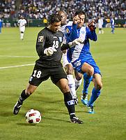 CARSON, CA – June 6, 2011: Honduras goalie Noel Valladares (18) battles Guatemala forward Carlos Ruiz (20) during the match between Guatemala and Honduras at the Home Depot Center in Carson, California. Final score Guatemala 0, Honduras 0.