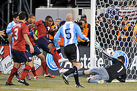 Juan Agudelo (9) of the United States shoots and scores past Argentina goalkeeper Mariano Andujar (1). The United States (USA) and Argentina (ARG) played to a 1-1 tie during an international friendly at the New Meadowlands Stadium in East Rutherford, NJ, on March 26, 2011.