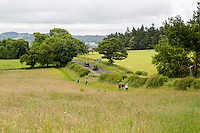 Northumberland, England, UK.  Hikers on Hadrian's Wall Footpath, near Military Road (B6318).