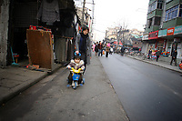 CHINA. Shanghai. A mother and child in the old town. Shanghai is a sprawling metropolis or 15 million people situated in south-east China. It is regarded as the country's showcase in development and modernity in modern China. This rapid development and modernization, never seen before on such a scale has however spawned countless environmental and social problems. 2008