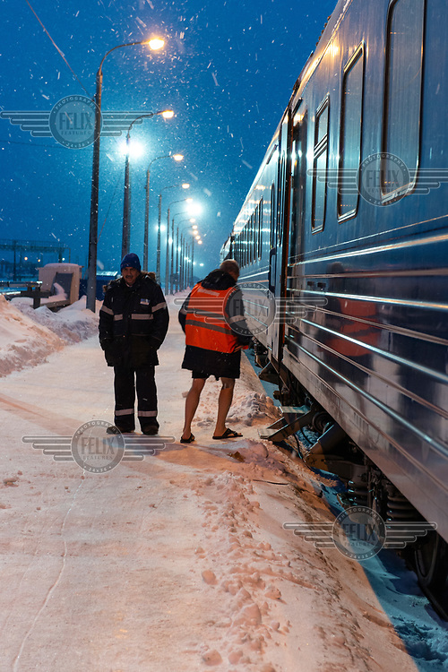 Staff, who are due to start a one to two month shift at the Gasprom Bovanenkovo gas field, prepare to board the Obskaya-Bovanenkovo railway train that will take them to their place of work.