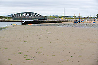 BNPS.co.uk (01202) 558833. <br /> Pic: BNPS<br /> <br /> Pictured: Black Bridge by Rockley Point in Poole Harbour, Dorset. <br /> <br /> A grieving mother who complained to a caravan park about the lack of safety measures at a beach where her son drowned has been offered a free holiday in response.<br /> <br /> Callum Osborne-Ward, 18, was swept away in front of his family moments after rescuing several children from a deadly riptide at Rockley Point in Poole Harbour, Dorset, last month.<br /> <br /> His devastated mother Ann Marie Osborne has since criticised holiday firm Haven, which owns the caravan park backing onto the waterway, for failing to warn visitors about the hidden riptide and advertising the beach on its website.