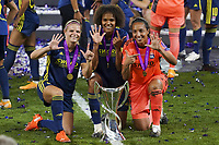 30th August 2020, San Sebastien, Spain;  Eug nie Le Sommer, Wendie Renard and Sarah Bouhaddi of Lyon celebrate with trophy after winning the UEFA Womens Champions League football match Final between VfL Wolfsburg and Olympique Lyonnais 3-1