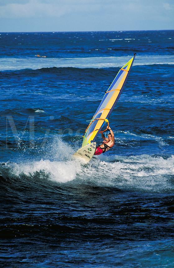 windsurfer jumping waves. Hawaii, Maui.