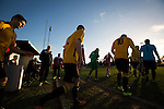 Alvechurch FC 3 Highgate United 0, 26/12/2016. Lye Meadow, Midland Football League Premier Division. The teams taking to the pitch at Lye Meadow before Alvechurch (in amber) hosted Highgate United in a Midland Football League premier division match. Originally founded in 1929 and reformed in 1996 after going bust, the club has plans to move from their current historic ground to a new purpose-built stadium in time for the 2017-18 season. Alvechurch won this particular match by 3-0, watched by 178 spectators, taking them back to the top of the league. Photo by Colin McPherson.