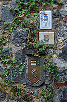 Rustic exterior wall with ivy, mailbox and house number, Proto Venere, Italy