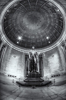The statue of Thomas Jefferson stands tall in the domed interior of the neoclassical Thomas Jefferson Memorial in Washington, DC.