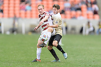 Houston, TX - Friday December 11, 2016: Derek Waldeck (29) of the Stanford Cardinal and Luis Argudo (2) of the Wake Forest Demon Deacons battle for control of the ball at the NCAA Men's Soccer Finals at BBVA Compass Stadium in Houston Texas.