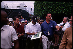 Tiger Woods signs autographs surrounded by security at the Genuity Open at Doral in Miami, Fl.