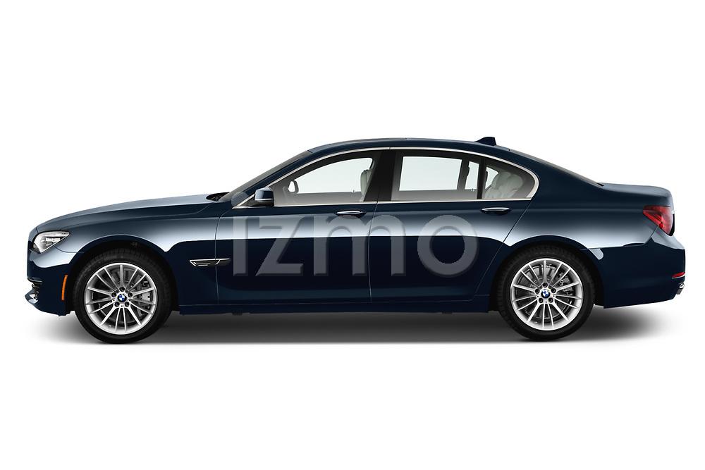 Driver side profile view of a 2013 BMW 7-Series 750i sedan.