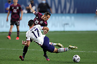 6th June 2021. Denver, Colorado, USA;  Mexico midfielder Andres Guardado with a heavy challenge on United States midfielder Sebastian Lletget during the CONCACAF Nations League finals between Mexico and the United States  at Empower Field at Mile High in Denver, CO.