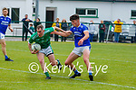 Cathal Moriarty Milltown-Castlemaine gets to the ball ahead of Sean Arthurs LAune Rangers during their Div 3 clash in Milltown on Sunday