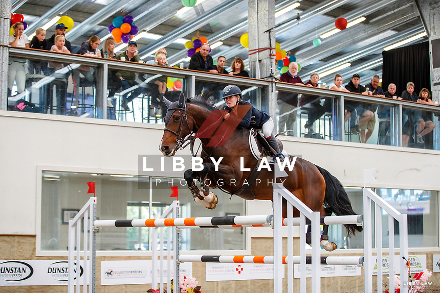 NZL-Annabel Francis rides LT Holst Elizabeth. Class 29: Fiber Fresh Horse 1.40m-1.45m 10K - FINAL. 2021 NZL-Easter Jumping Festival presented by McIntosh Global Equestrian and Equestrian Entries. NEC Taupo. Sunday 4 April. Copyright Photo: Libby Law Photography