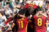 Calcio, Serie A: Roma vs Napoli. Roma, stadio Olimpico, 25 aprile 2016.<br /> Roma's Radja Nainggolan, bottom center, back to camera, is hidden by teammates' hugs after scoring the winning goal during the Italian Serie A football match between Roma and Napoli at Rome's Olympic stadium, 25 April 2016. Roma won 1-0.<br /> UPDATE IMAGES PRESS/Riccardo De Luca