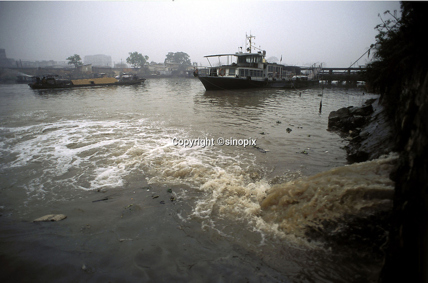 Polluted and untreated water is pumped from a drinks bottling plant directly into a tributary of the Pearl river outside Guangzhou, China..