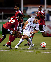 Peri Marosevic (9) battles against Nicholas Walker (17). US Under 20 Men's National Team played to a scoreless draw vs Trinidad & Tobago, advancing after winning 4-3 on penalty kicks at the Marvin Lee Stadium in Macoya, Trinidad on March 13th, 2009 during the 2009 CONCACAF U-20 Championship.