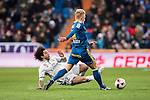 Marcelo Vieira Da Silva (l) of Real Madrid battles for the ball with Daniel Wass of RC Celta de Vigo during their Copa del Rey 2016-17 Quarter-final match between Real Madrid and Celta de Vigo at the Santiago Bernabéu Stadium on 18 January 2017 in Madrid, Spain. Photo by Diego Gonzalez Souto / Power Sport Images