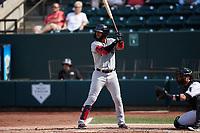 Miguel Aparicio (8) of the Hickory Crawdads at bat against the Winston-Salem Dash at Truist Stadium on July 10, 2021 in Winston-Salem, North Carolina. (Brian Westerholt/Four Seam Images)