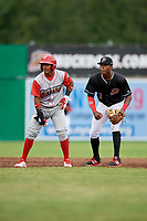 Batavia Muckdogs shortstop Demetrius Sims (3) check Brayan Gonzalez (2) as he leads off second base during a game against the Williamsport Crosscutters on June 22, 2018 at Dwyer Stadium in Batavia, New York.  Williamsport defeated Batavia 9-7.  (Mike Janes/Four Seam Images)