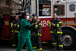 Firefighters applaud healthcare workers in front of the Wyckoff Heights Medical Center during the coronavirus pandemic (COVID-19) in the Brooklyn borough of New York City on April 5, 2020.  Photograph by Michael Nagle