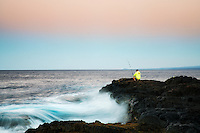 Fisherman at sunrise. South Point. Hawaii, (The Big Island)