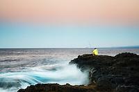 Fisherman at sunrise. South Point. Hawaii, (The Big Island)