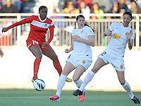 Tiffany McCarthy (14) of the Washington Spirit goes against Adriana Martin (8) and Amy Barczuk (22) of the Western New York Flash. The Washington Spirit tied The Western New York 1-1 in the home opener of The National Women's Soccer League, at Maryland SoccerPlex, Saturday April 20, 2013.