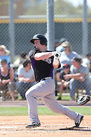 Jared Simon #18 of the Colorado Rockies bats during a Minor League Spring Training Game against the San Francisco Giants at the Colorado Rockies Spring Training Complex on March 18, 2014 in Scottsdale, Arizona. (Larry Goren/Four Seam Images)
