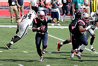 27th September 2020, Foxborough, New England, USA;  New England Patriots quarterback Cam Newton (1) points out trouble as he scrambles from the pocket during the game between the New England Patriots and the Las Vegas Raiders